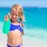 Little adorable girl in swimsuit with suntan Royalty Free Stock Image