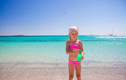 Little adorable girl in swimsuit with suntan Stock Images