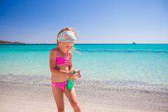 Little adorable girl in swimsuit with suntan Royalty Free Stock Images