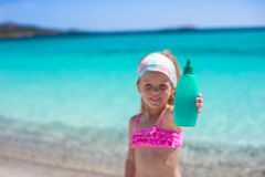 Little adorable girl in swimsuit with suntan Royalty Free Stock Photography