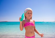 Little adorable girl in swimsuit with suntan Stock Photography
