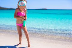 Little adorable girl in swimsuit with suntan Stock Image