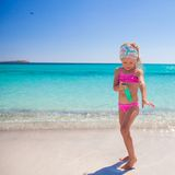 Little adorable girl in swimsuit with suntan Stock Photos