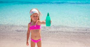 Little adorable girl in swimsuit with suntan Royalty Free Stock Photos