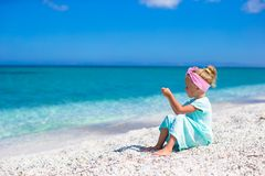 Little adorable girl take picture of the sea on Stock Photos