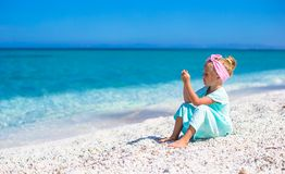 Little adorable girl take picture of the sea on Stock Photography