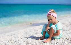Little adorable girl talking at phone during beach Stock Photography