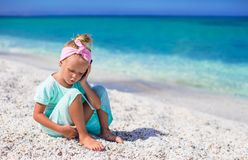 Little adorable girl talking at phone during beach Stock Photo