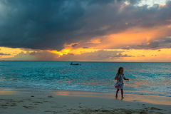 Little adorable girl walking in beautiful sunset Stock Photo