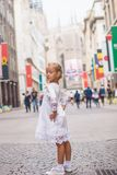 Little adorable girl walking in Milan on italian Royalty Free Stock Images