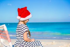 Little adorable girl wearing Santa hat at Royalty Free Stock Photography