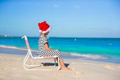 Little adorable girl wearing Santa hat at Stock Photo