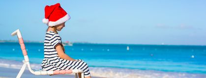 Little adorable girl wearing Santa hat at Royalty Free Stock Images
