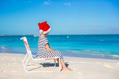 Little adorable girl wearing Santa hat at tropical Stock Photography