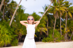 Little adorable girl in white long dress on a Stock Photo