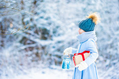 Little adorable girl with in winter day outdoors Stock Photo