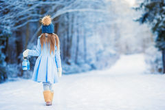 Little adorable girl with in winter day outdoors Stock Image