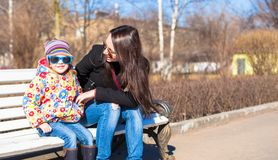 Little adorable girl and young mother at sunny day Stock Photography