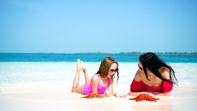 Little adorable girl and young mother at tropical beach stock footage