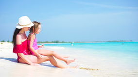 Little adorable girl and young mother at tropical beach stock video