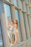 Little adorable girls in airport near big window Stock Photography