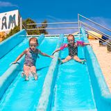 Little adorable girls at aquapark during summer Stock Photo