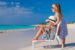 Little adorable girls in beach chair during Stock Photography