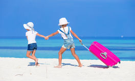 Little adorable girls with big suitcase on Stock Photo