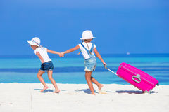 Little adorable girls with big suitcase on Royalty Free Stock Photography