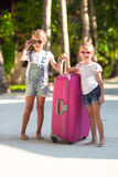 Little adorable girls with big suitcase on Royalty Free Stock Photos
