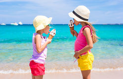 Little adorable girls eating ice cream on tropical Stock Image