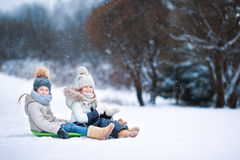 Little adorable girls enjoy a sleigh ride. Child Stock Images