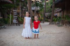 Little adorable girls in exotic resort in nice Stock Image