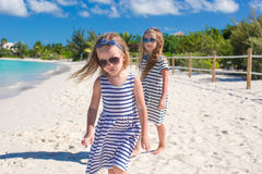 Little adorable girls have fun on the beach Stock Photos
