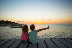 Little adorable girls in nice dress on the beach Stock Photos