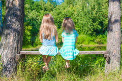 Little adorable girls outdoors at summer time Stock Images