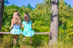 Little adorable girls outdoors at summer time Royalty Free Stock Images