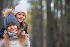 Little adorable girls outdoors at warm sunny Royalty Free Stock Photos