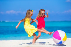 Little adorable girls playing on beach with air Royalty Free Stock Photography