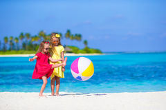 Little adorable girls playing on beach with ball. Little girls playing on beach with ball Royalty Free Stock Image