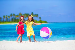 Little adorable girls playing on beach with ball. Little girls playing on beach with ball Royalty Free Stock Photo