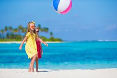 Little adorable girls playing on beach with ball Royalty Free Stock Photography