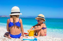 Little adorable girls playing with beach toys royalty free stock images