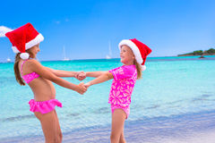 Little adorable girls in Santa hats during Royalty Free Stock Photo