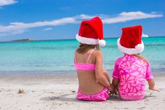 Little adorable girls in Santa hats during their Stock Photography