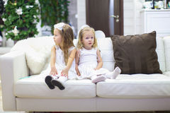 Little adorable girls waiting their Christmas Royalty Free Stock Image