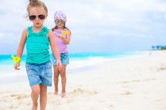 Little adorable girls on white tropical beach Stock Images