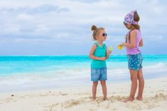 Little adorable girls on white tropical beach Royalty Free Stock Photo