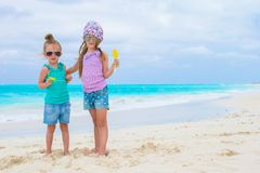 Little adorable girls on white tropical beach Royalty Free Stock Photography