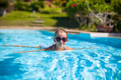 Little adorable happy girl swim in the swimming Stock Images